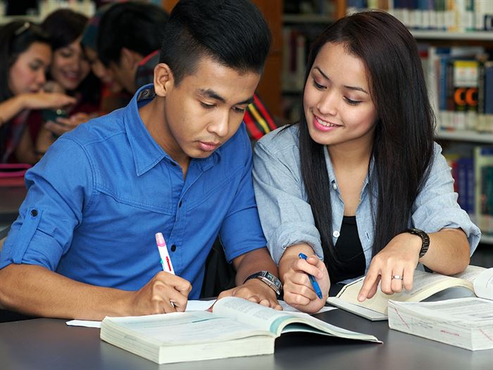 two international students studying shutterstock 172412789